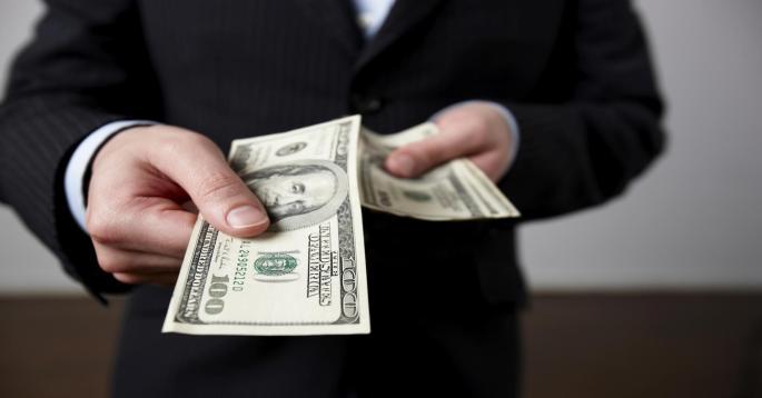 100338136-businessman_handing_cash_gettyp.1910x1000.jpg